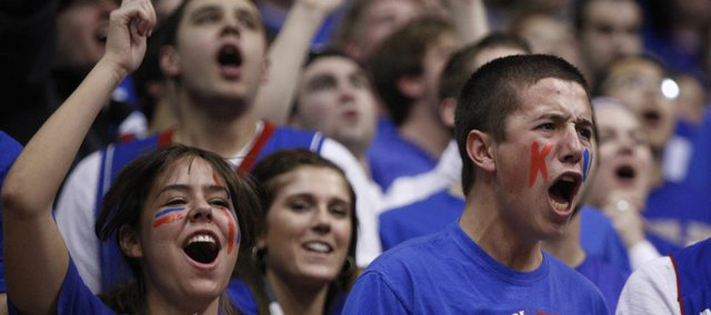 Kansas University students K.J. Hadjis, Colorado Springs, Colorado junior, left, and Tyler Betz, Montrose, Colorado sophomore get wild during the second half on Saturday, Feb. 18, 2012 at Allen Fieldhouse.
