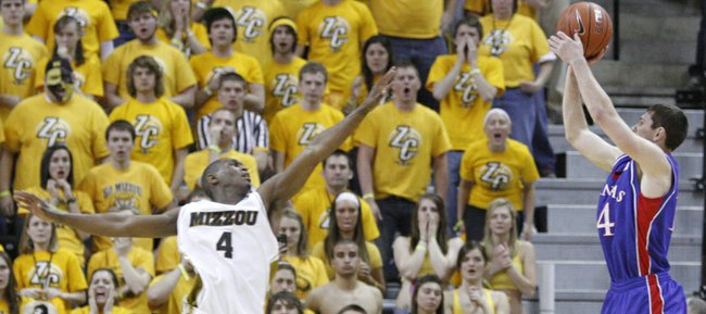Kansas guard Tyrel Reed shoots a three-pointer over Missouri guard J.T. Tiller during the second half, Saturday, March, 6 2010 at Mizzou Arena.