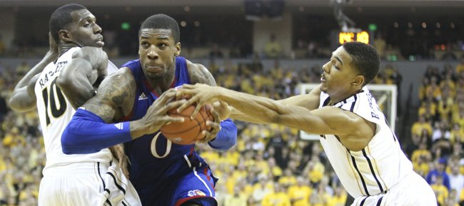Kansas forward Thomas Robinson drives between Missouri defenders Ricardo Ratliffe and Phil Pressey during the second half on Saturday, Feb. 4, 2012 at Mizzou Arena.