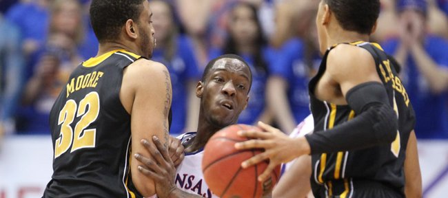 Kansas guard Tyshawn Taylor fights through a pick by Missouri forward Steve Moore as he defends MU guard Phil Pressey during the first half on Saturday, Feb. 25, 2012 at Allen Fieldhouse.
