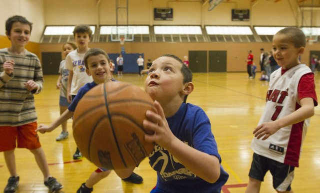 Six-year-old Ryne Fulscher takes a shot during a shoot around before the start of a three-on-three basketball tournament sponsored by  the Boys and Girls Club of Lawrence and the KU Sports Management Club Saturday, Feb. 25, 2012 at Robinson Gymnasium on KU's campus.