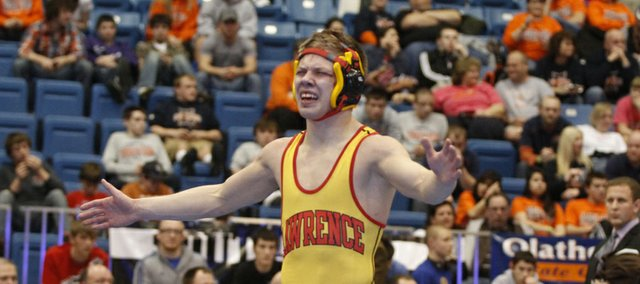 Lawrence High's Hunter Haralson celebrates after defeating Gardner-Edgerton's TJ Stokes in the 126-pound finals on Saturday, Feb. 25, 2012, in Wichita.