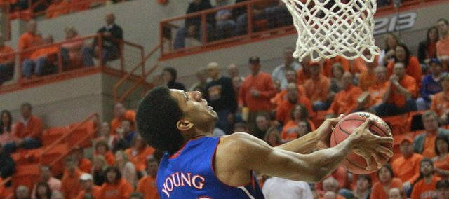 Kansas forward Kevin Young goes up for a reverse dunk during the first half of KU's game against Oklahoma State on Monday, Feb. 27, 2012, at Gallagher-Iba Arena in Stillwater, Okla.
