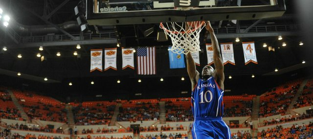Kansas' Tyshawn Taylor completes a dunk in the second half for two of his 27 points.