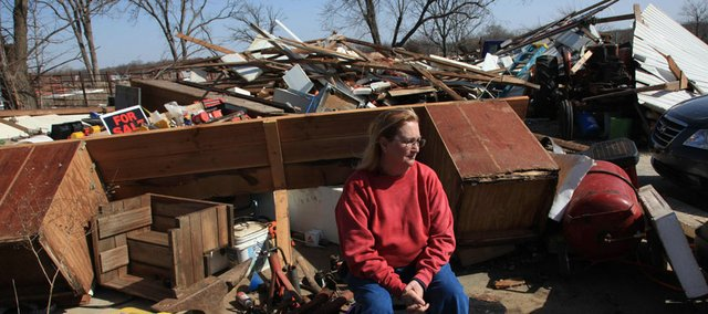 Joyce Barkley sits Thursday near what's left of her barn and outbuildings on Woodson Road in southern Douglas County. Tuesday night's EF-0 tornado, with 65 mph to 85 mph winds, damaged or destroyed many structures in the area.