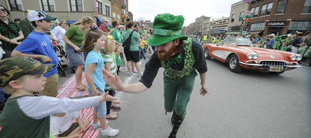 A leprechaun was giving out high fives during the annual Lawrence St. Patrick's Day Parade Thursday, March 17, 2011.