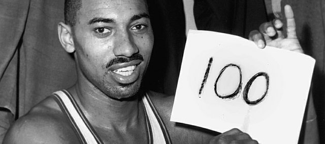 "In this file photo from March 2, 1962, Wilt Chamberlain of the Philadelphia Warriors holds a sign reading ""100"" in the dressing room in Hershey, Pa., after he scored 100 points as the Warriors defeated the New York Knickerbockers, 169-147."