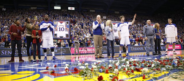 Kansas seniors Tyshawn Taylor, left, Conner Teahan and Jordan Juenemann are recognized before the fieldhouse crowd with their families prior to tipoff against Texas on Saturday, March 3, 2012 at Allen Fieldhouse.