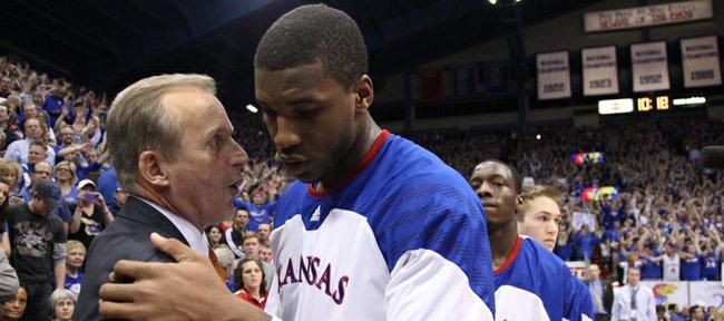 Texas head coach Rick Barnes has congratulatory words for Kansas forward Thomas Robinson after the Jayhawks' win.