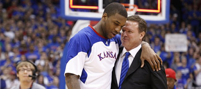 Kansas forward Thomas Robinson is hugged by head coach Bill Self as he is recognized before the fieldhouse during the senior speeches.
