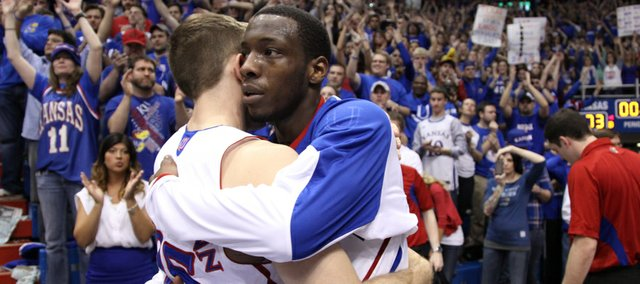 Kansas guard Tyshawn Taylor hugs fellow senior Jordan Juenemann after their final game at Allen Fieldhouse.