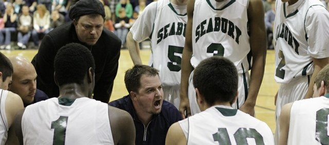 Seabury boys coach Ashley Battles talks to the team during a timeout late in overtime during Bishop Seabury Academy's win against University Academy on Friday, Feb. 17, 2012.