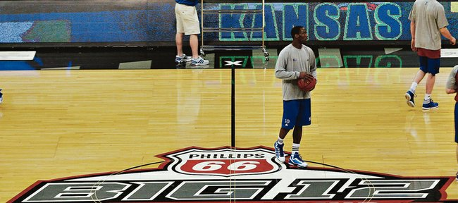 Kansas University guard Tyshawn Taylor stands at halfcourt of the Sprint Center during a brief shootaround in preparation for the Big 12 tournament opener against Texas A&amp;M in this 2012 file photo. The Big 12 signed an extension Friday to keep the league&#39;s men&#39;s basketball tournament in K.C. through 2016.