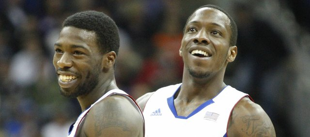 Kansas guard Elijah Johnson and Tyshawn Taylor (10) have a laugh after a layup by Johnson ended in the ball stuck up on the rim during the first half on Thursday, March 8, 2012.