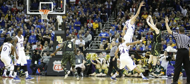 Kansas center Jeff Withey can't block a three-pointer from Baylor guard Brady Heslip during the second half on Friday, March 9, 2012.