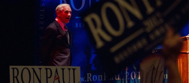 Republican presidential candidate walks on stage to the excitement of the crowd during a Ron Paul rally held Friday, March 9, 2012 at the Lied Center on the campus of Kansas University.