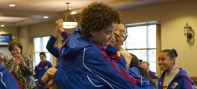Kansas junior Monica Engelman, left, hugs senior forward Aishah Sutherland while the rest of the team celebrates after the team learned its NCAA tournament fate during a tournament selection watch party held in the Naismith Room in Allen Fieldhouse Monday, March 12, 2012. The Jayhawks received the number eleven seed in the Des Moines region and will face  sixth seeded Nebraska in the first round.