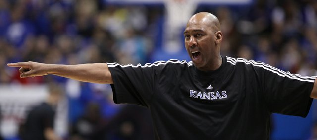 Kansas assistant coach Danny Manning directs traffic during warmups prior to tipoff against Texas Tech on Saturday, Feb. 18, 2012 at Allen Fieldhouse.