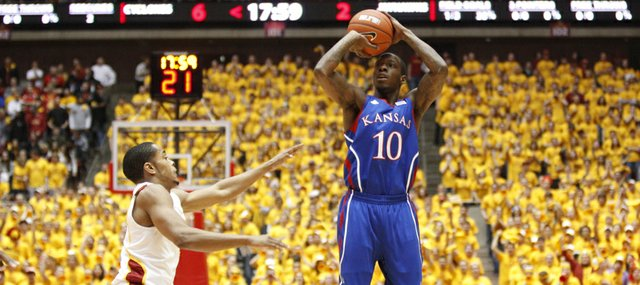 Kansas guard Tyshawn Taylor pulls up for a three over Iowa State guard Chris Allen during the first half on Saturday, Jan. 28, 2012 at Hilton Coliseum.