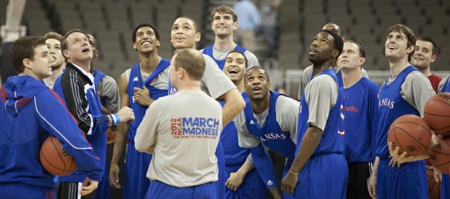 The Jayhawks and head coach Bill Self look up with anticipation as they follow a half-court shot from a player at the end of practice on Thursday, March 15, 2012 at Century Link Center in Omaha.