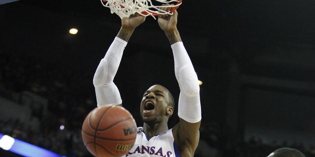 Kansas forward Thomas Robinson delivers a jam before Detroit center LaMarcus Lowe during the first half on Friday, March 16, 2012 at CenturyLink Center in Omaha.