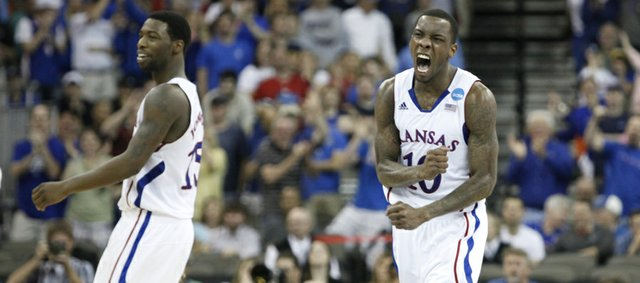 Kansas guard Tyshawn Taylor goes wild after a three by teammate Elijah Johnson, left, put the Jayhawks up by one for their first lead of the game against Purdue during the second half on Sunday, March 18, 2012 at CenturyLink Center in Omaha.