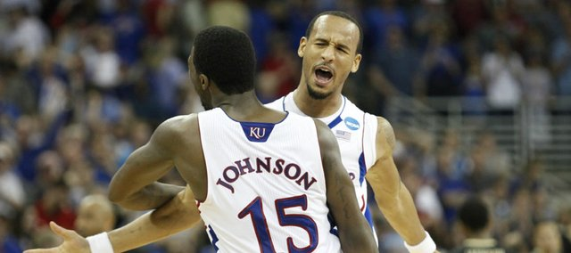 Kansas teammates Travis Releford and Elijah Johnson celebrate the win over Purdue on Sunday, March 18, 2012 at CenturyLink Center in Omaha.