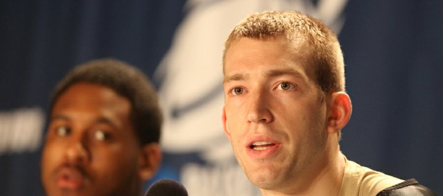 Purdue forward Robbie Hummel answers a question during a press conference on Saturday, March 17, 2012 at CenturyLink Center in Omaha. At left is Purdue guard Terone Johnson.