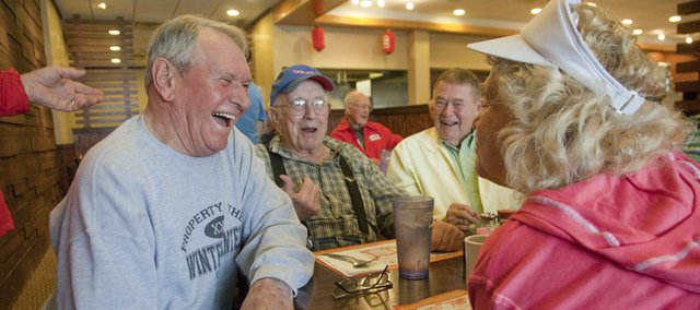 Former employees of the Tecumseh DuPont chemical plant eat at King Buffet in Lawrence for their monthly gathering. From left are Charlie Wintermantel, Robert Gentry, Tom Hanenkrat and Paula Hladky.