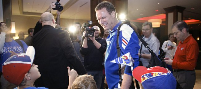 Kansas coach Bill Self greets several young Jayhawk fans following a brief interview with media members as the team arrives on Wednesday, March 21, 2012, at the Hyatt Regency St. Louis at the Arch.