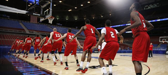 The North Carolina State Wolfpack warm up before practice at the Edward Jones Dome in St. Louis.