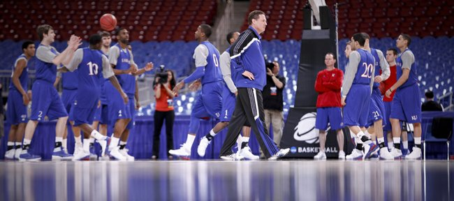 Kansas head coach Bill Self paces the court as the Jayhawks warm up with passing drills during the beginning of practice the Edward Jones Dome in St. Louis.