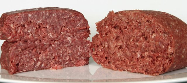 "This Thursday, March 15, 2012 photo shows ground beef containing what is derisively referred to as ""pink slime,"" or what the meat industry calls ""lean, finely textured beef,"" right, and pure 85% lean ground beef, in Concord, N.H. Food served in Lawrence schools does not include the treated meat."