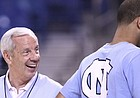 North Carolina head coach Roy Williams laughs with injured guard Kendall Marshall during a day of press conferences and practices at the Edward Jones Dome in St. Louis.