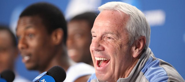 North Carolina head coach Roy Williams laughs as his players talk about video games during a press conference on Saturday, March 24, 2012 at the Edward Jones Dome in St. Louis.