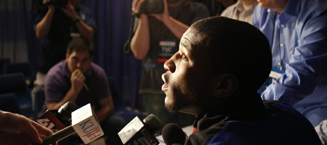 Kansas forward Thomas Robinson listens to a question from a media member during a breakout session with reporters on Saturday, March 24, 2012 at the Edward Jones Dome in St. Louis.