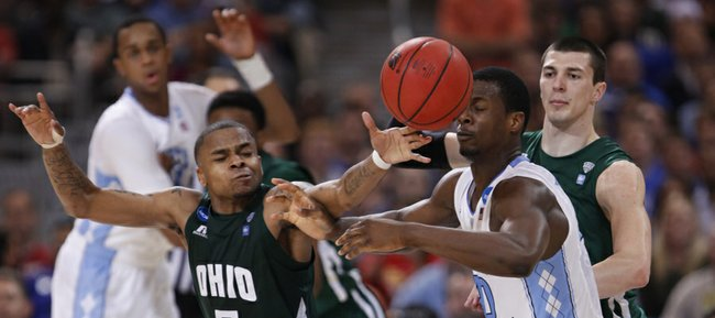 Ohio guard D.J. Cooper knocks the ball loose from North Carolina forward Harrison Barnes during the second half on Friday, March 23, 2012 at the Edward Jones Dome in St. Louis.