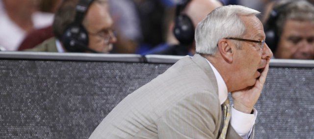 North Carolina head coach Roy Williams watches late in the second half on Sunday,  March 25, 2012 at the Edward Jones Dome in St. Louis.