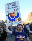 "Sam Stepp, KU graduate, carries a ""Dancin' in the Big Easy"" sign and was one among hundreds who headed downtown Sunday after Jayhawks defeated North Carolina to head to the Final Four."