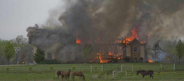 A home southwest of Lawrence on East 850 Road burns after possibly being struck by lightning about 12:45 p.m. Tuesday. In addition to Kanwaka Township, firefighters from Wakarusa Township, Eudora Township, Willow Springs Township, Lecompton and Lawrence-Douglas County Fire Medical responded to the fire.