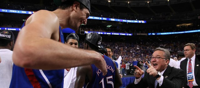 Kansas center Jeff Withey celebrates with director of basketball operations Barry Hinson after the Jayhawks&#39; 80-67 win over North Carolina to advance to the Final Four on Sunday,  March 25, 2012 at the Edward Jones Dome in St. Louis.