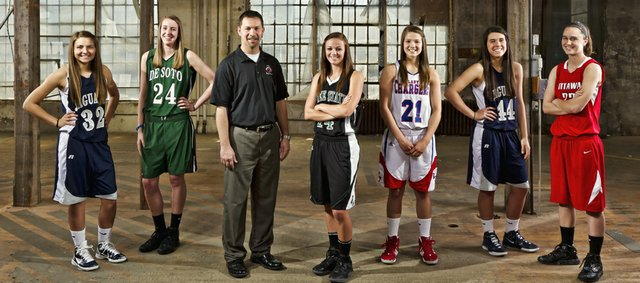 2012 All-Area girl's basketball team includes, from left, Tanner Tripp, Mill Valley, Megan Bonar, De Soto, coach Cliff McCullough, Ottawa, Lynn Robinson, Free State, Amber Moore, Santa Fe Trail, Stephanie Lichtenauer, Mill Valley, Jordan Baldwin, Ottawa.