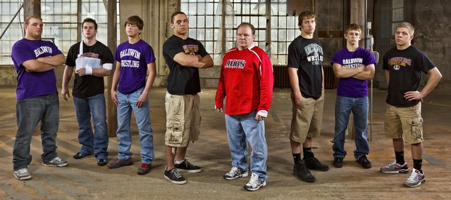 The 2011-2012 Journal-World All-Area Wrestling Team, from left, is Colton Bonner, Baldwin; Nick Pursel, Lawrence; Bryce Shoemaker, Baldwin; Reece Wright-Conklin, Lawrence; coach Pat Naughton, Lawrence; Cole Cannon, De Soto; Andrew Morgan, Baldwin; Hunter Haralson, Lawrence. Not pictured from the first team are Zach Callahan, Mill Valley; Tyler Dickman, Mill Valley; and Spencer Wilson, Free State.
