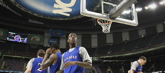 Kansas guard Tyshawn Taylor scans around the Superdome as the Jayhawks take the court for practice on Friday, March 30, 2012.