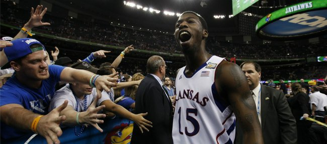 Kansas guard Elijah Johnson takes in the roar of the crowd as he leaves the floor following the Jayhawks' 64-62 win over Ohio State on Saturday, March 31, 2012 at the Superdome.