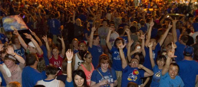 Fans storm Mass. Street on Saturday following KU's 64-62 victory over Ohio State.