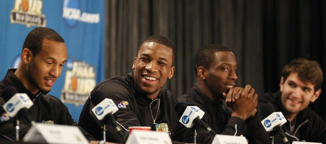 Kansas forward Thomas Robinson, second from left, smiles as he and teammates Travis Releford, left, Tyshawn Taylor and Jeff Withey respond to questions during a press conferenc