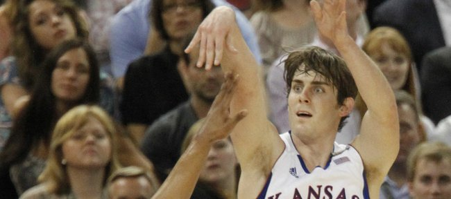 Connor Teahan (2) launches a three-point basket in the second-half of  KU's 64-62 win over Ohio State.