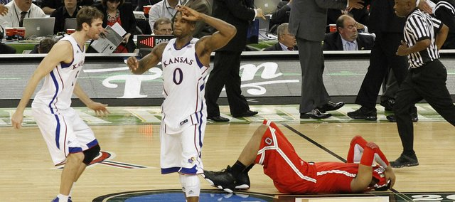 Jeff Withey, left, and Robinson (0) celebrate KU's 64-62 win over Ohio State to put the Jayhawks the Championship game agains Kentucky, Monday night. At left is Ohio State's Jared Sullinger.