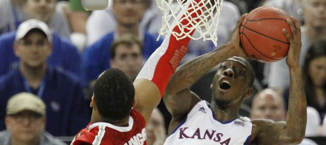 Tyshawn Taylor (10) leaps for a shot in the second-half of KU's 64-62 win over Ohio State to put the Jayhawks the Championship game agains Kentucky, Monday night.